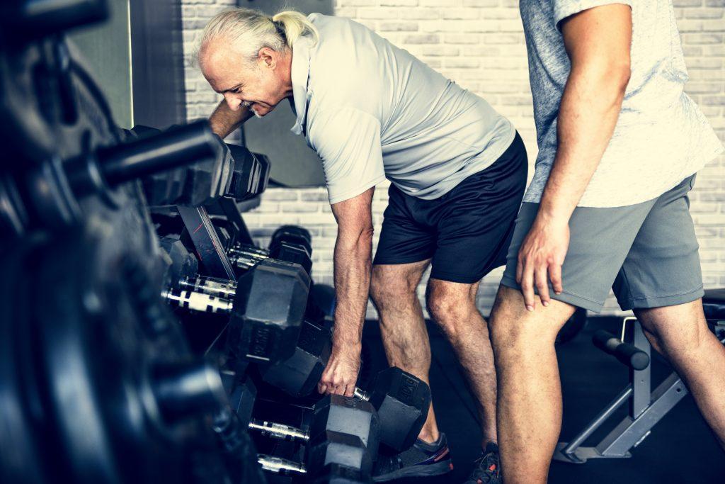 men exercising time under tension tut training weights