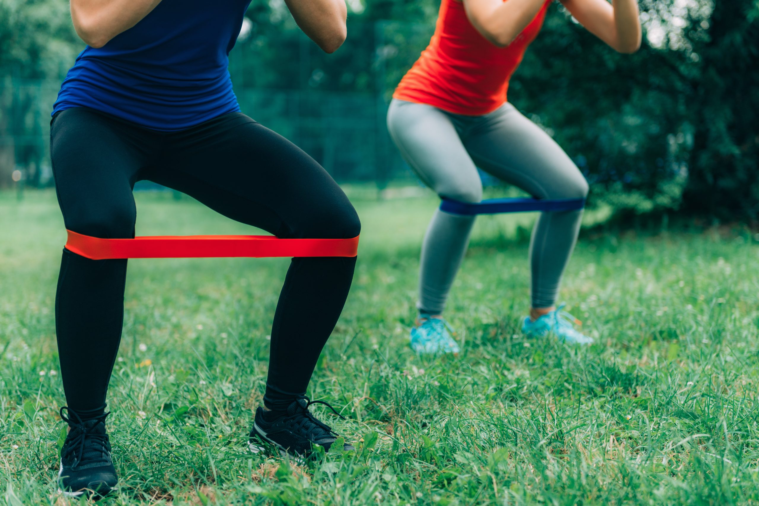 women exercising with resistance band training program