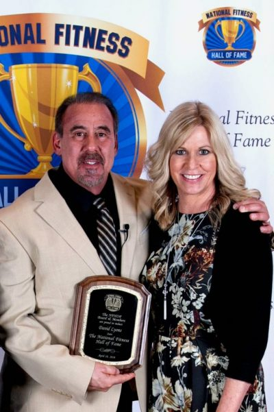 David Lyons and Kendra with the National Fitness Hall of Fame Award