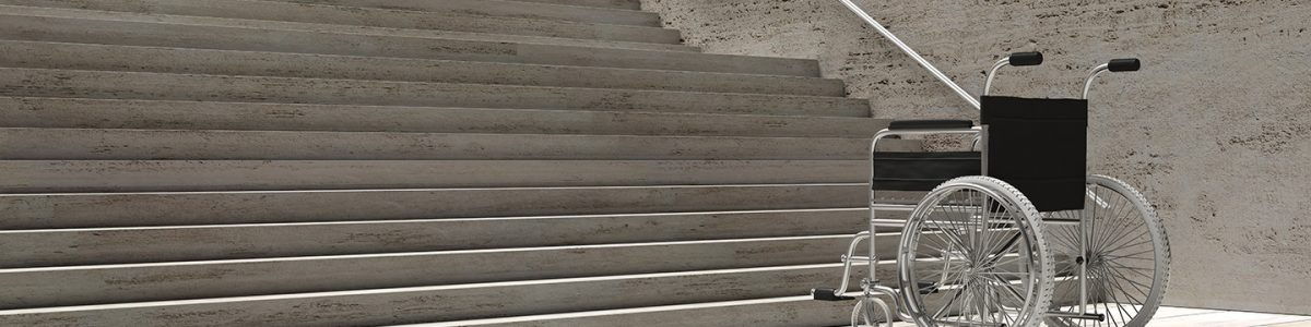 wheelchair-empty-infront-of-concrete-stairs