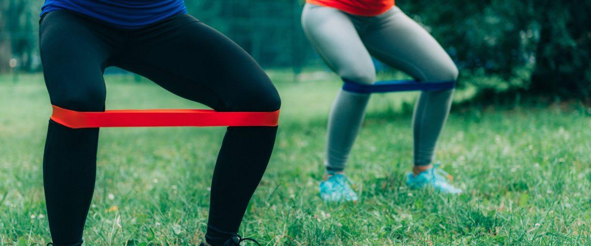 women exercising with resistance band training program
